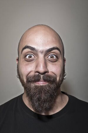 funny bearded man: man with stupid face and dark light Stock Photo