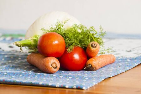tomatoes, carrots and fennel on blue tablecloth on the table Stock Photo - 12954772