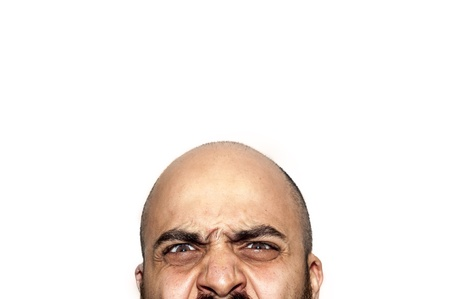 half face angry expression looking on white background Stock Photo - 12954617