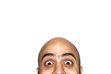 half funny face expression looking on white background Stock Photo - 12954624