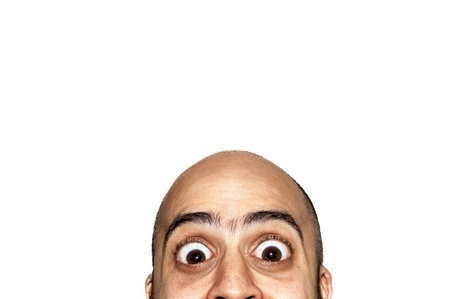 half funny face big eyes expression looking on white background Stock Photo