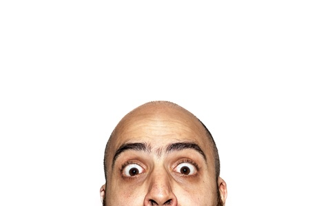 half funny face expression looking on white background Stock Photo - 12954618