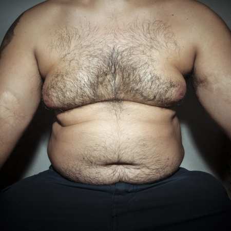 belly fat and hairy man with hands photo