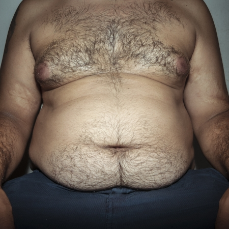 hairy male: belly fat and hairy man with hands