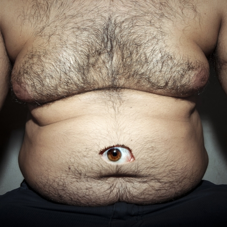 hairy chest: monstrous belly fat of dirty man with eye
