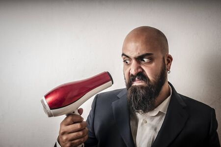 man bearded and jacket with hairdraier and funny expressions on white background Stock Photo - 15355218