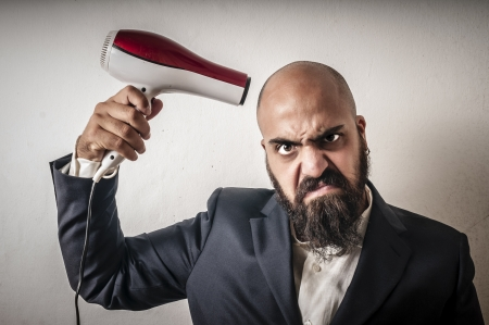 phon: man bearded and jacket with hairdraier and funny expressions on white background Stock Photo