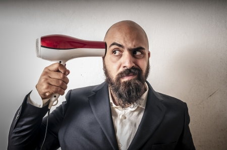 man bearded and jacket with hairdraier and funny expressions on white background Stock Photo - 15355965