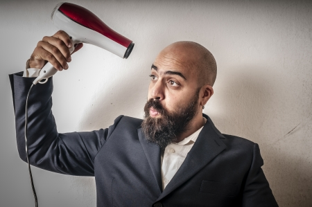 man bearded and jacket with hairdraier and funny expressions on white background Stock Photo - 15355964