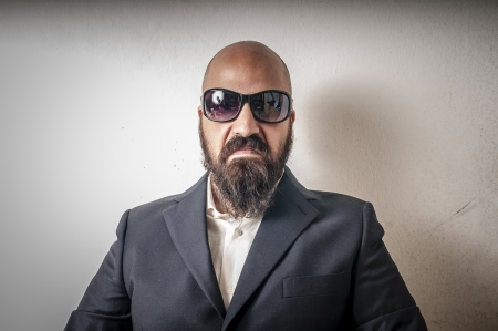 bouncer with jacket and sunglasses on white background photo