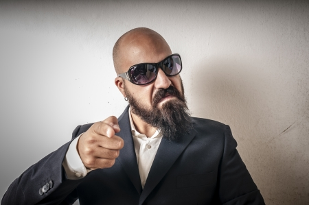 bouncer with jacket and sunglasses on white background Stock Photo - 15355099