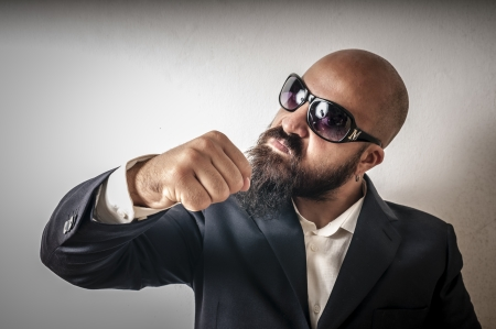 bouncer with jacket and sunglasses on white background Stock Photo