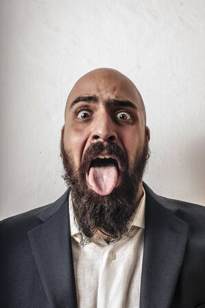 funny bearded man: elegant bearded man with jacket and funny expressions on white background