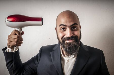stupid body: man bearded and jacket with hairdraier and funny expressions on white background Stock Photo