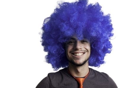 Crazy guy with blue wig on white background photo