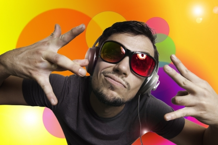 Crazy guy with headphones on colorful background photo
