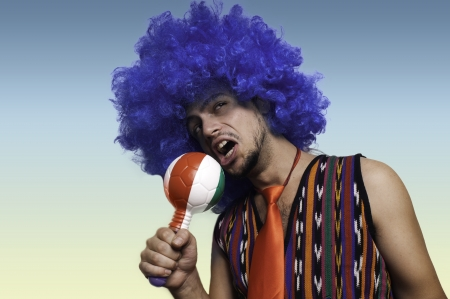 Crazy guy with blue wig on colorful background photo