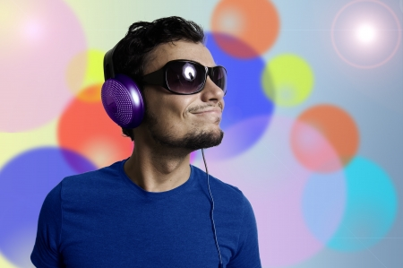 Crazy guy with headphones on colorful background Stock Photo - 15482958