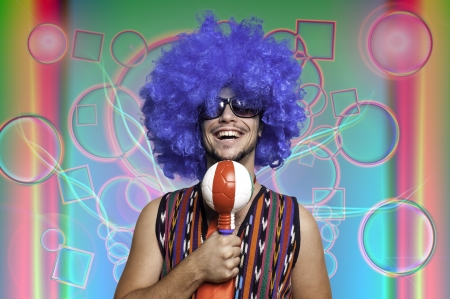 Crazy guy with blue wig on colorful background Stock Photo - 15482983