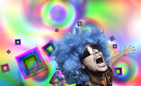 Crazy guy with blue wig on colorful background Stock Photo - 15482984