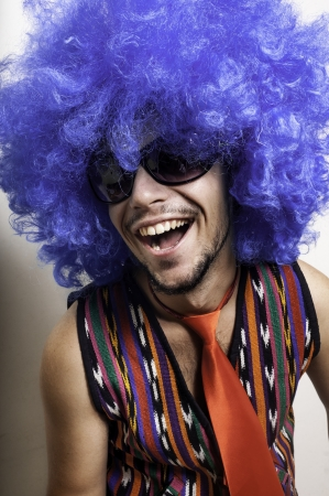 crazy guy with sunglasses and blue wig on white background Stock Photo - 15475549