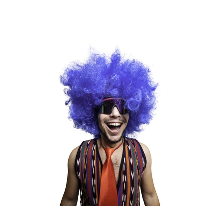 crazy guy with sunglasses and blue wig on white background photo