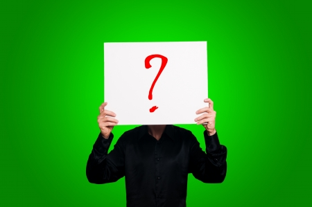 doubt question mark on green background Stock Photo - 15693029