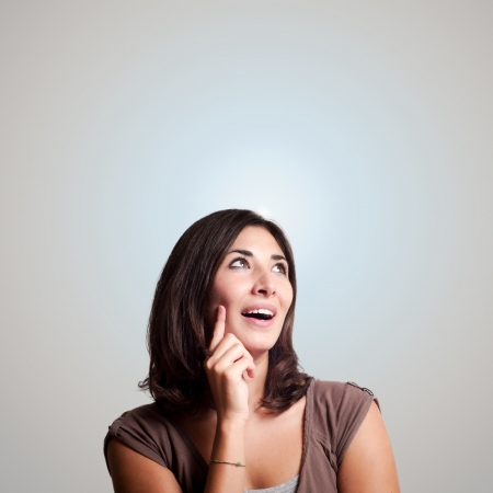 1 person: beautiful girl thinking on gray background