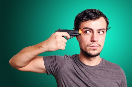 suicide guy with gun on blue background photo