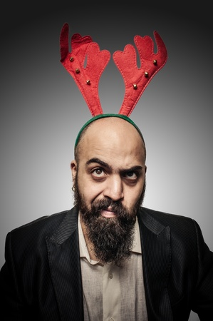 funny bearded man: doubt christmas bearded man with funny expressions on grey background Stock Photo