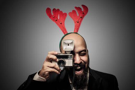 christmas bearded man holding old camera on grey background Stock Photo - 16658249