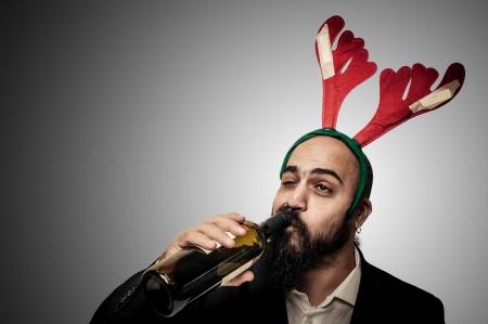 amused: drunk modern elegant santa claus babbo natale on grey background