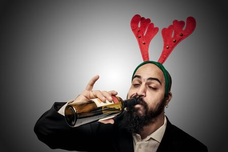 drunk modern elegant santa claus babbo natale on grey background photo