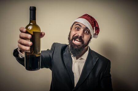 funny bearded man: drunk modern elegant santa claus babbo natale on grey background