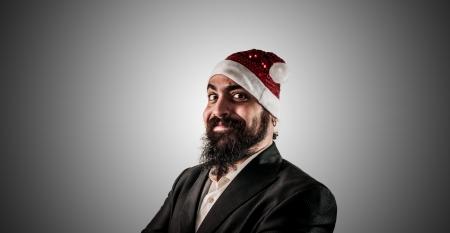 babbo natale: smiling modern elegant santa claus babbo natale on grey background