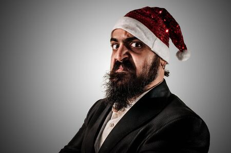 babbo natale: angry modern elegant santa claus babbo natale on grey background Stock Photo