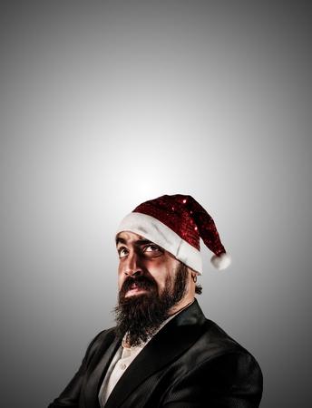 babbo natale: thinker modern elegant santa claus babbo natale on grey background