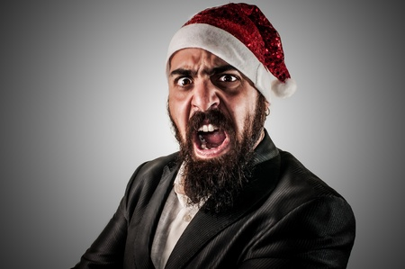 babbo natale: angry modern elegant santa claus babbo natale on grey background Stock Photo