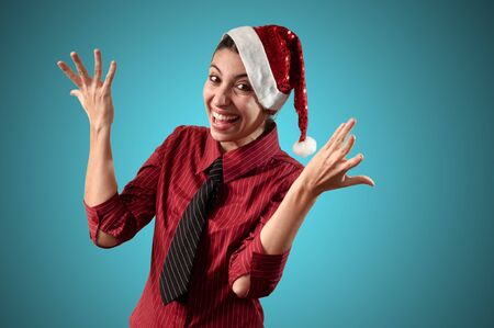 smiling business christmas girl on blue background photo