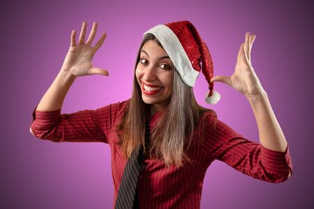 smiling business christmas girl on pink background photo