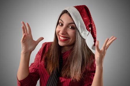 smiling business christmas girl on grey background photo