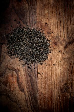 breen: breen tea leaves on brown wood Stock Photo