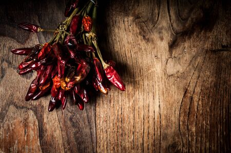 rustic food: dried hot red chilies on brown textured wood