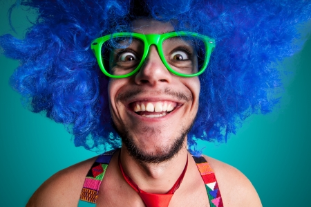 boy  naked: Funny guy naked with blue wig and red tie on green backgrund