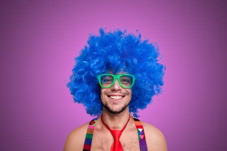 Funny guy naked with blue wig and red tie on green backgrund