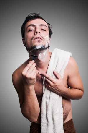 sexy man who shaves his beard on grey background Stock Photo - 17283298
