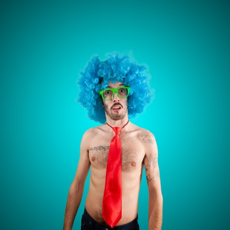 funny man with blue wig on blue background photo
