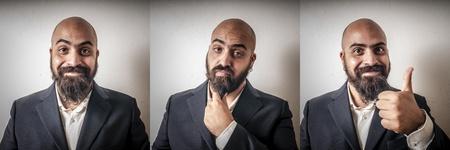 bärtiger mann: Satz von eleganten b�rtigen Mannes mit verschiedenen Ausdr�cken auf grauem Hintergrund