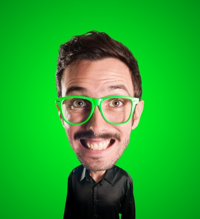 puppet man with big head on green background photo
