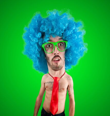 funny carnival puppet man with big head  on green background photo